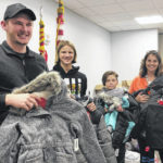 Coats for Kids provides new coats for students