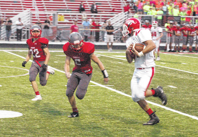 In this Times-Gazette file photo from Sept. 4, 2018, Hillsboro's Luke Middleton runs with a key fourth down reception that netted 35 yards at Goshen High School late in the second quarter.