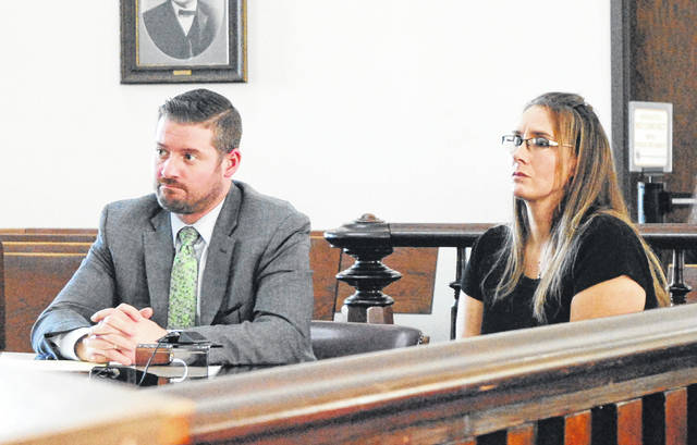 Misty Cowan, right, sits in Highland County Common Pleas Court on Wednesday with attorney Will Nesbitt, left.