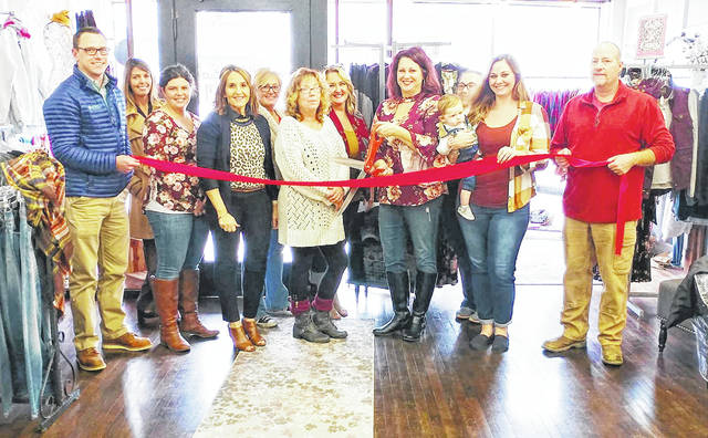 Members of the Highland County Chamber of Commerce and Salty Gypsy Boutique staff are pictured at a grand opening on Nov. 9.
