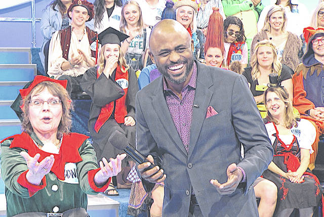 "Greenfield resident Bonnie Baldridge, left, is pictured with show host Wayne Brady during a taping this summer of ""Let's Make A Deal"" that was filmed in Van Nuys, Calif. Baldridge, who works in accounts payable for the Greenfield Exempted Village Schools, said the show will air on CBS sometime from 10-11 a.m. on Thursday, Jan. 10. She said there are two ""Let's Make A Deal"" shows that air during that one-hour time slot and she is not sure which one her's will be. She said she would be glad to talk about the experience she and a daughter had on the show after it airs, but until then she did not want to give away too many details. ""It was a lot of fun, I'll tell you that,"" she said. ""…It was rather a spur of the moment event, not to mention a one in a lifetime opportunity. The whole crew, as well as the other contestants, were so much fun and very friendly, so we had a blast, as you can imagine."""