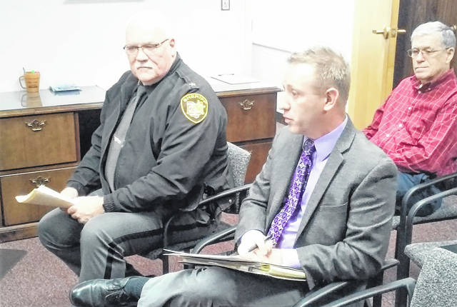 At Wednesday's commissioners meeting, Highland County Sheriff Donnie Barrera, left, and Aramark representative Mike Colvin, center, discuss Aramark's proposal to have a new body scanner installed at the Highland County Jail. Also in attendance was Highland County Auditor Bill Fawley, shown at right.