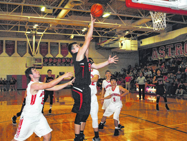 Fairfield's James Bentley scores in the paint on Friday at East Clinton High School where the Lions battled the Astros in boys basketball action.