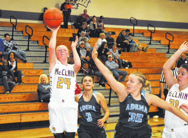 McClain's Kyla Burchett rises up for a shot over an Adena defender on Thursday at McClain High School where the Lady Tigers battled the Lady Warriors in varsity basketball action.
