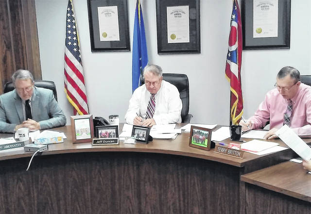 Highland County Commissioners Gary Abernathy, Jeff Duncan and Terry Britton are shown during Wednesday's meeting where approval was given for funding a land bank.