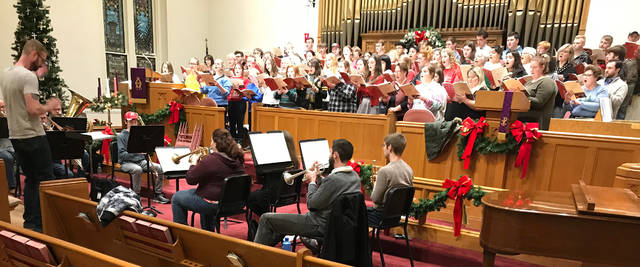 "The Highland County Community Chorus, under the direction of David White (left) will present A Holiday Concert at 7 p.m. Thursday, Dec. 20 at the Hillsboro First United Methodist Church. The concert will feature the masterwork ""Gloria"" by British composer John Rutter, for SATB choir, soloists, organ, brass octet and percussion. The concert will also feature the Hillsboro High School Symphonic Choir, also directed by White, and the Highland County Community Children's Choir, under the direction of Kay Tyler and Laura Jacky. Tickets to the concert are $10 for adults (students are free) and may be purchased at the door. The church is located at 133 E. Walnut St. and is handicap accessible. For more information check out www.facebook.com/groups/highlandcountycommunitychorus/."