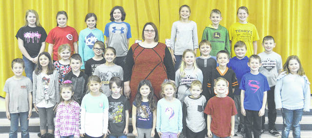 The following children were chosen as Students of the Month at Lynchburg-Clay Elementary for December. The students were chosen by their teacher for displaying positive behavior, being responsible and respectful, doing good deeds as well as their school work, and for being a positive role model for others. Pictured are (front row, l-r) Shelby Grey (PK), Lacey Warner (1), Roderick Jenkins (1), Kelsey Davis (K), Livy Waits (K), Teagan Williamson (K) and Logan Saylor (K); (second row, l-r) Mason Brault (2), Kelsey McPherson (3), Levi Throckmorton (3), Brittany Young (5), Principal Angie Godby, Gabby Grabill (2), Clayton Ferguson (2), Colton Grabill (1) and Lilly Moore (1); (third row, l-r) Elizabeth Shope (2), Josie Kneipp (1), Wesley Herbert (3), Tyler Herbert (2) and Mason Warnock (3); (fourth row, l-r) Brooklyne Allen (4), Julianne Vesey (4), Addyson Cordrey (4), Annie Keaton (4), Audrey Barry (5), Xavier Higgins (5) and Caitlyn Collins (5). Absent from the picture is Jack Bennett (PK).