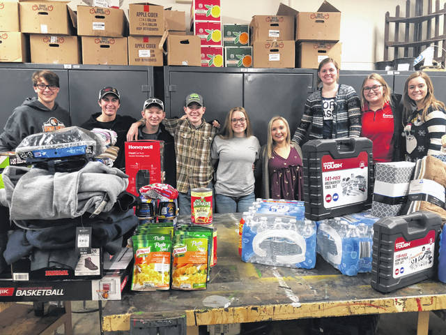 The Fairfield FFA Officer Team spent its Dec. 15 morning shopping at Walmart for its annual Adopt A Christmas Child program. The chapter set out jugs to collect money from every class at the Fairfield Local Schools. In total the chapter raised $2,000 to spend on families in need during the holiday season. The officer team bought food, clothes and toys for two different families in the community, hopes to spread some joy and holiday spirit to these families and brighten their Christmas this year. The members want to thank everyone who made donations and supported the program. Pictured, from left, are Brayden Grooms, Kohler Bartley, Spencer Crothers, Thomas Fraysier, Ally Davis, Alexis Tompkins, Paige Teeters, Bre Flint and Rachel Schuler.