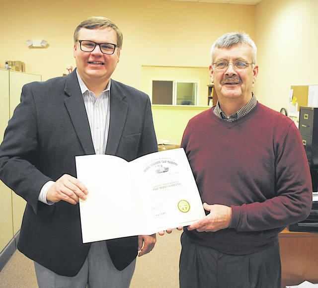 "Stephen Caraway, left, southwest regional liaison for Governor John Kasich's office, presents a document Thursday to Times-Gazette Editor Jeff Gilliland recognizing the newspaper's 200th anniversary, which has been celebrated throughout the year. The first publication of what was then called the Hillsborough Gazette and Highland Advertiser came off the press on the afternoon of June 18, 1818. The governor's letter of recognition says: ""On behalf of the State of Ohio, we are proud to recognize the 200th anniversary of The Times-Gazette. Community newspapers are a vital element to Ohio's local communities, providing information while promoting local commerce, free enterprise and public service. We commend the hard work of all those involved with these publications throughout the years, and we extend our best wishes for many more years of continued success."""