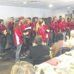 HHS Symphonic Choir performs for Hillsboro Rotary