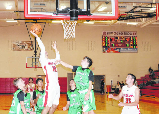 Hillsboro's Ethan Watson rises above a host of St. Patrick (Ky.) defenders on Saturday night at Hillsboro High School where the Indians and the Saints battled as part of the Ohio Valley Hoops Classic.