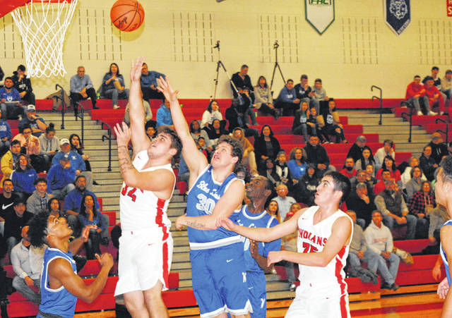 Hillsboro senior Josh Keets attempts a layup in the first half Friday at Hillsboro High School where the Indians took on the Washington Blue Lions.