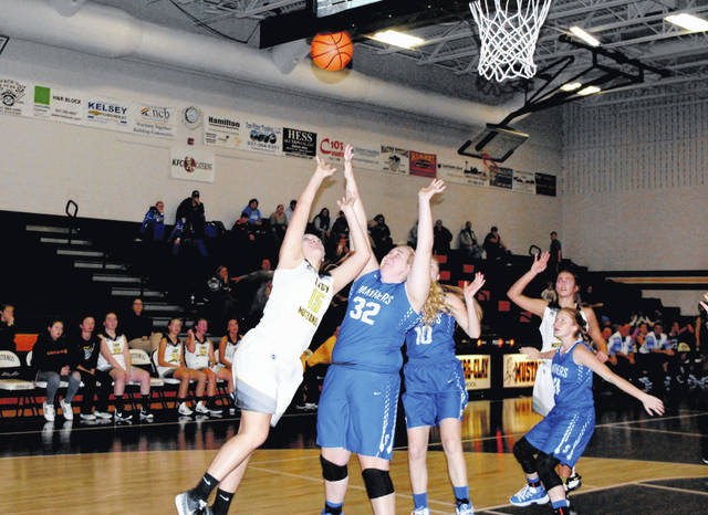 Lynchburg-Clay's Chelsea Hart attempts a layup over a Southeastern defender on Thursday at Lynchburg-Clay High School.