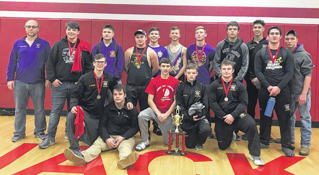 The McClain varisty wrestling team gathers for a picture at Jackson High School where they opened their season with a second place finish in the American Legion Post 81 Invitational.
