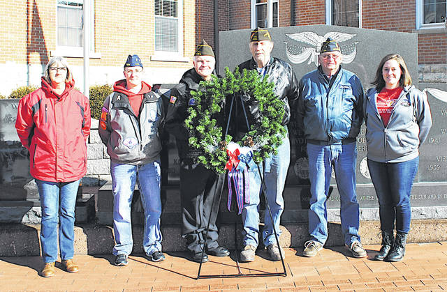 Six representatives from local veterans organizations placed a wreath Friday at the Highland County Veterans Memorial on the courthouse lawn in Hillsboro in recognition of the 77th anniversary of the Japanese attack on Pearl Harbor. Pictured, from left, are Becky Williams and Stephanie Roland representing the Highland County Veterans Service Office, Hillsboro VFW Auxiliary and Support Our Troops Of Highland County; David Pinney with the Highland County Veterans Honor Guard; Hillsboro VFW Post 9094 Commander Rick Wilkin; John Walker representing Mowrystown American Legion Post 694; and Cailin Hoskins with the Highland County Veterans Service Office.