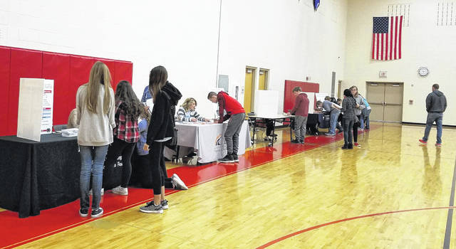 Hillsboro eighth grade students are shown going through the Real Money, Real World simulation with various vendors.