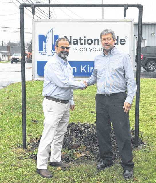 Russ Newman, left, and Tom Kirker are pictured in front of the new Newman Insurance location in West Union.