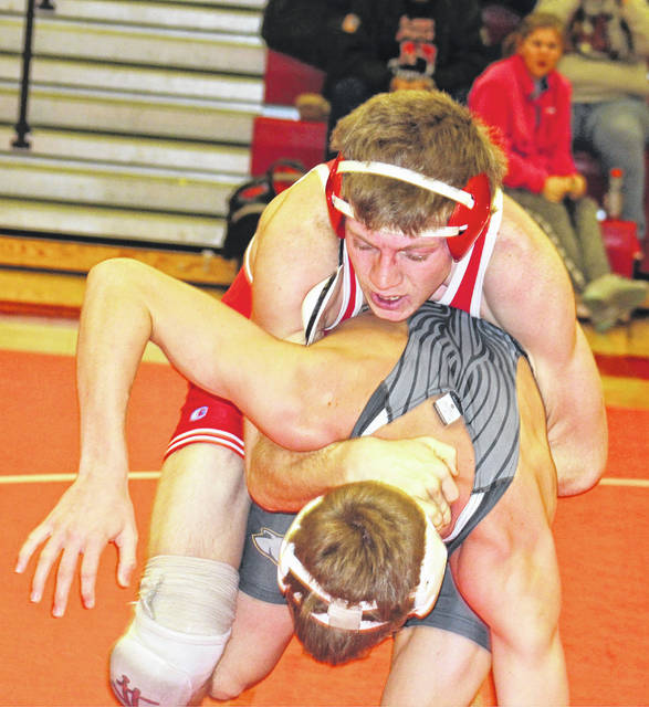 Hillsboro's Scott Eastes battles Jayden LeBeau of Miami Trace in the 152 pound wrestling matchup Thursday at Hillsboro High School where the Indians took on the Panthers in FAC varsity wrestling action.
