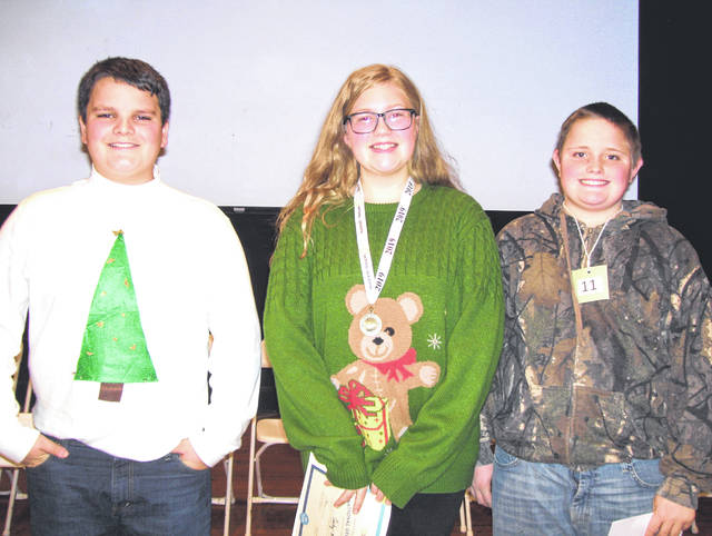 The Greenfield Middle School Geography Bee took place on the morning of Friday, Dec. 21 in the McClain Auditorium. The bee champion was eighth grader Carly Sims (center). The second place finisher was eighth grader Robbie Wise and third place was earned by seventh grader Anthony Mootispaw.
