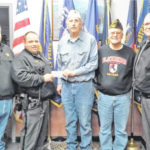 Hillsboro VFW presents check to Highland County Peace Officers Assn. for annual Shop-With-A-Cop program.