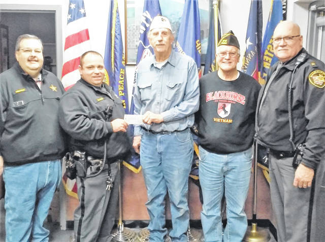 Hillsboro VFW Post 9094 presented a check for $250 Thursday to members of the Highland County Peace Officers Association in support of this year's Shop-With-A-Cop program. PIctured, from left, are HCPO President Damon Haught, HCPO Treasurer Mike Gaines, VFW Post 9094 Commander Rick Wilkin, VFW Post 9094 Quartermaster David Penny and Highland County Sheriff Donnie Barrera.
