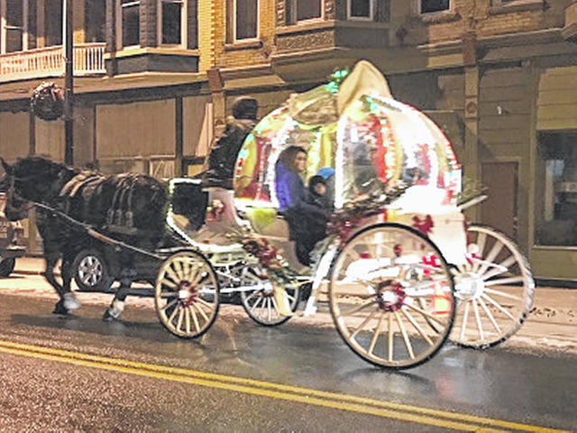 "Shown in downtown Lynchburg a year ago is the ""Cinderella"" carriage that will offer rides again this weekend."