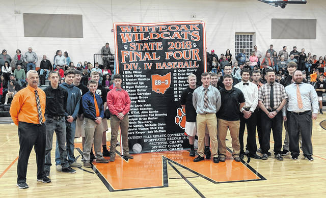 Whiteoak High School honored it's 2018 varsity baseball players and coaching staff for their 2018 OHSAA State Final Four appearance on Friday before the start of the varsity basketball game between Whiteoak and Fairfield. The team gathers at midcourt for a photo with their commemorative Final Four banner.