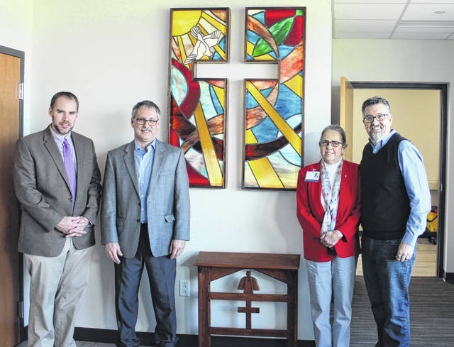 Shown from left are Rev. Jason Link of First Presbyterian Church, Pastor Kurtis King of Trinity United Methodist Church, Adena Board of Trustees Chairwoman Virginia Wettersten and Pastor Chris Brown of Tabernacle Baptist Church.