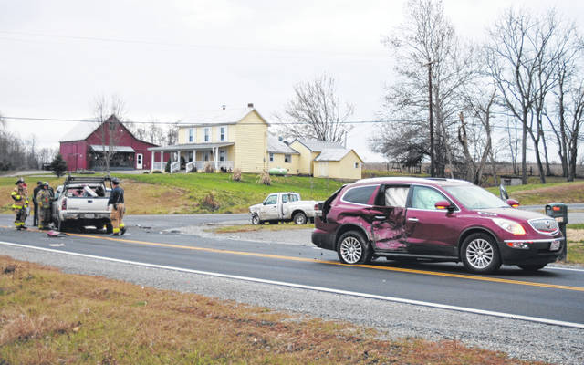 Shown are three vehicles involved in a chain-reaction wreck Monday on SR 73 near Prospect Road that sent two people to the hospital.