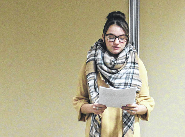 Laci Muhlenkamp reads her award-winning essay at Thursday's Highland County Drug Abuse Coalition meeting.