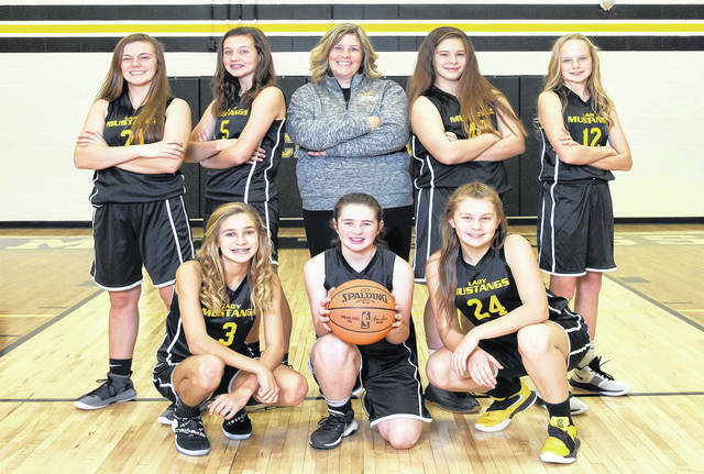 Lynchburg-Clay 7th grade girls finished 1st in Division I with a record of 10-0. Pictured front row (l-r): Macy Etienne, Allison Rockey and Autumn Griffith. Pictured back row(l-r): Lainie Lunsford, Jade Massey, Coach Amy Snyder, Ella Barry and Addison West.