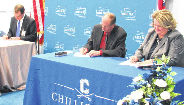 Officials sign an agreement to form the Mount Logan Elementary School/Early Childhood Center in Chillicothe.
