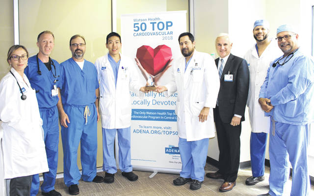 Adena cardiovascular providers and President and CEO Jeff Graham are pictured with the system's Top 50 Heart Hospital Award.