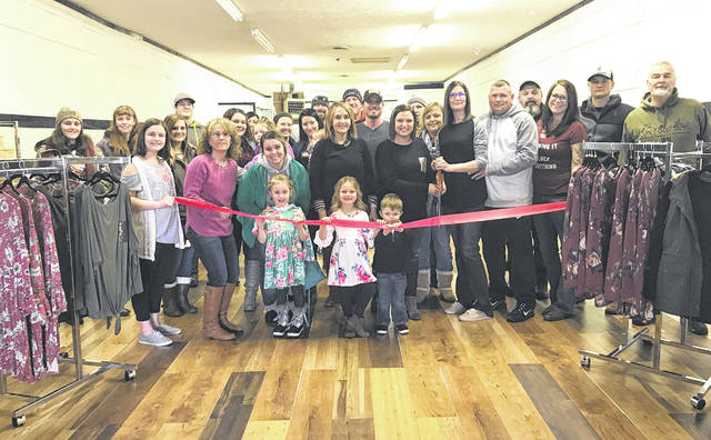 Owners Jacquelyn Penwell and Courtney Rayburn, along with Highland County Chamber of Commerce representatives and others, are pictured Saturday at the grand opening of AnnMarie Boutique in Greenfield.