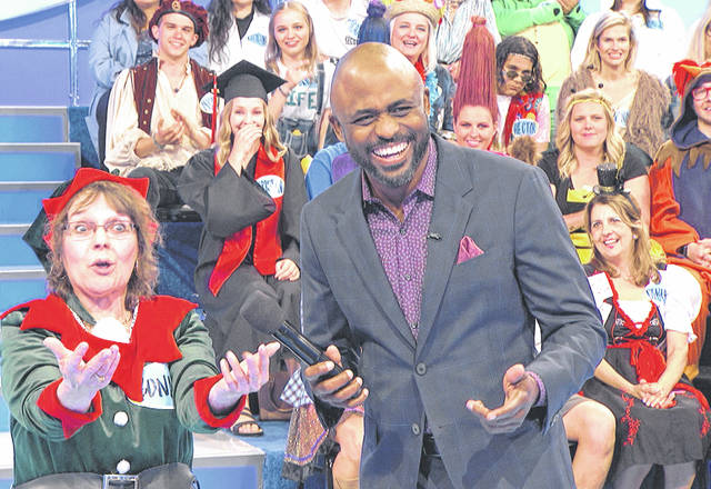 "Greenfield resident Bonnie Baldridge, left, is pictured with show host Wayne Brady during a June taping of ""Let's Make A Deal."" The show aired Thursday morning on CBS and can be viewed on the show's website."