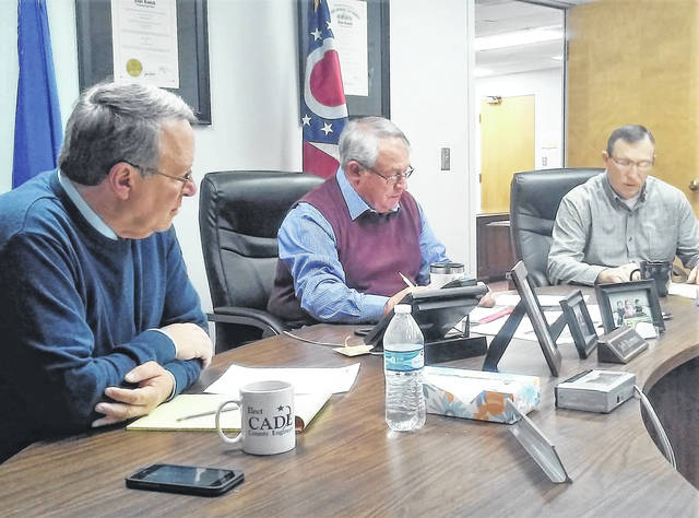 Highland County commissioners Gary Abernathy, Jeff Duncan and Terry Britton are shown at Monday's organizational meeting, their first meeting of the new year, where a new bi-weekly meeting time of 9 a.m. Monday and Wednesday was approved.
