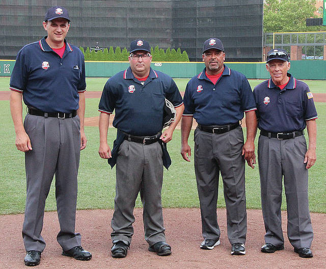 Sidney native and Anna resident Scott Barr, second from left, poses with an umpire crew before the Division II state championship last June at Huntington Park in Columbus. The rest of the crew is made Chris Prokes, left, of Vandalia; Roger Dicks, second from right, of Cincinnati; and Tim Kuhner, formerly of Minster.