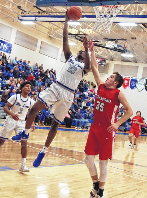 Hillsboro's Brad Miller defends against Washington's Blaise Tayese on Friday at Washington High School where the Indians traveled to take on the Blue Lions in FAC basketball action