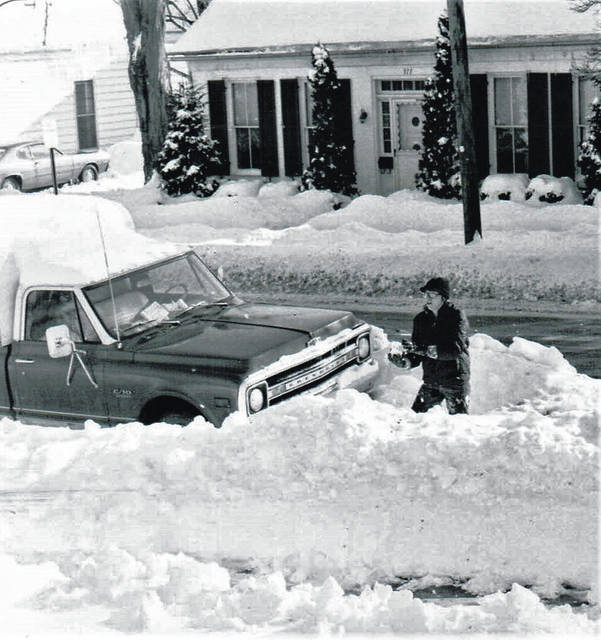 Hillsboro resident Glenna Walker, who was 15 years old when the Blizzard of 1978 dumped more than a foot of snow on top of what was already on the ground in Highland County, is shown shoveling out her pickup truck on West Walnut Street.