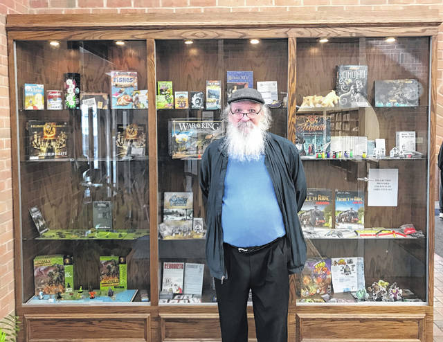 Greg Stewart is pictured in front of his board games that were recently on display at the Greenfield Branch Library.