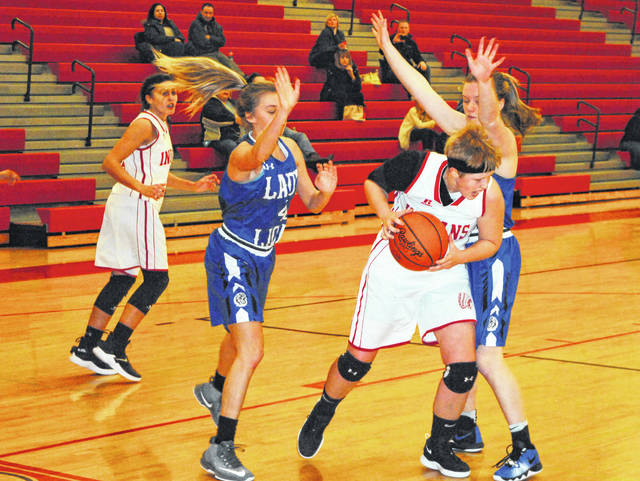 Hillsboro senior Lana Grover secures a defensive rebound on Monday at Hillsboro High School where the Lady Indians hosted the Lady Blue Lions of Washington Court House.