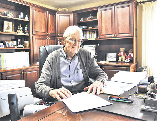 Bob Hodson looks over some of his records in his office in his Hillsboro home.