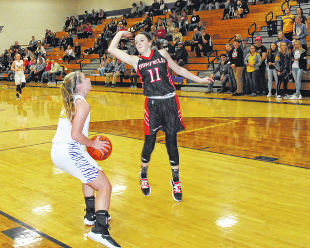 McClain senior Kelli Uhrig fakes a shot to get Fairfield freshman Emma Fouch into the air before finishing the fast break with a layup Saturday at McClain High School where the Lady Tigers and Lady Lions sought bragging rights in a cross-county rivalry matchup.