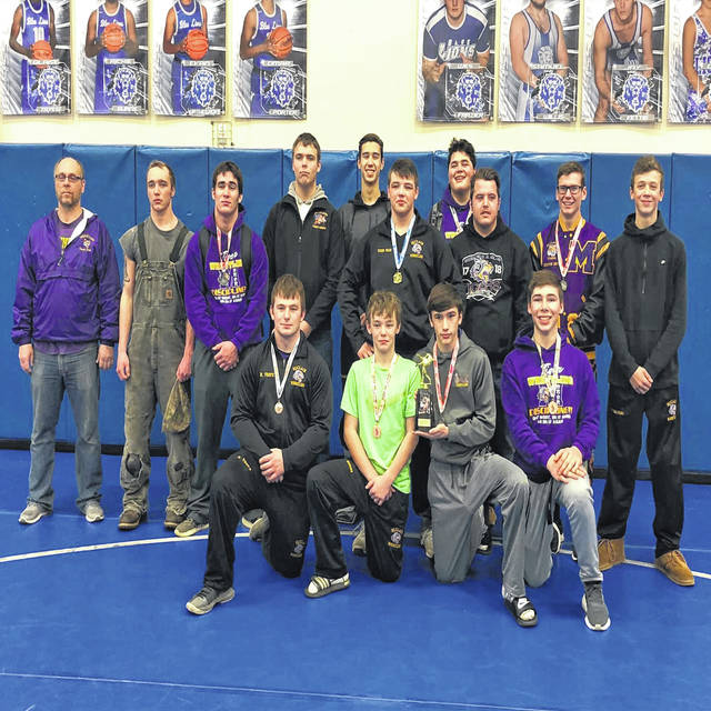 The McClain varsity Wrestling team poses for a group photo on Saturday at Washington High School where the Tigers took part in the 12 team Washington Court House Bracket Tournament. The Tigers performed well and finished in second place.