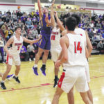 McClain travels to Jackson falls 56-48