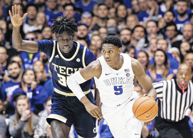 Duke's RJ Barrett (5) dribbles past Georgia Tech's Abdoulaye Gueye during the second half of an NCAA college basketball game in Durham, N.C., Saturday, Jan. 26, 2019. Duke won 66-53.