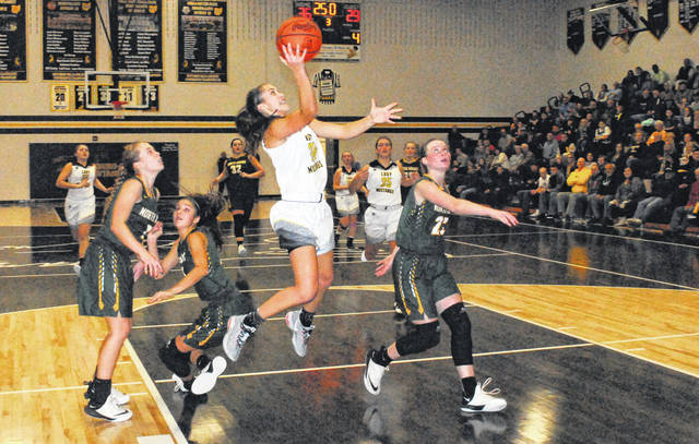 Lynchburg-Clay's Peyton Scott finishes off the fast break with a layup after beating three North Adams defenders off the dribble Thursday at Lynchburg-Clay High School where the Lady Mustangs hosted the Lady Green Devils in a key SHAC matchup.