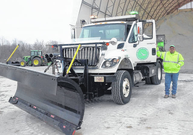 "His snow plow fully loaded, Hillsboro ODOT driver Jamie ""Bubba"" Barton makes ready to do battle with whatever Old Man Winter throws at him during an anticipated weekend snow storm."