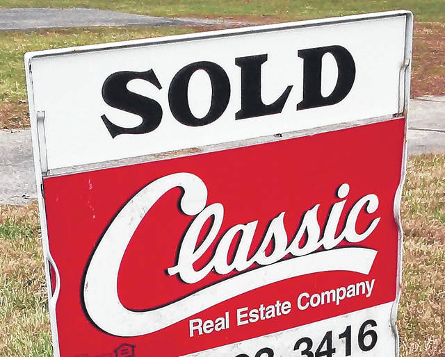 Signs like this one have been popping up more and more in town and out in the country, with realtors crediting an improved economy and continued low interest rates for the increase in real estate sales.