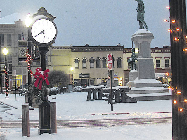 Snow on the courthouse lawn made for a picturesque scene at dusk Saturday, although the winter weather system that brought it caused some mayhem on area roads.